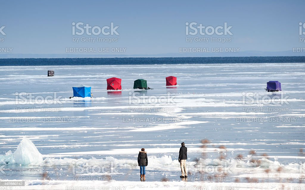 Ice fishing huts on Lake Superior stock photo