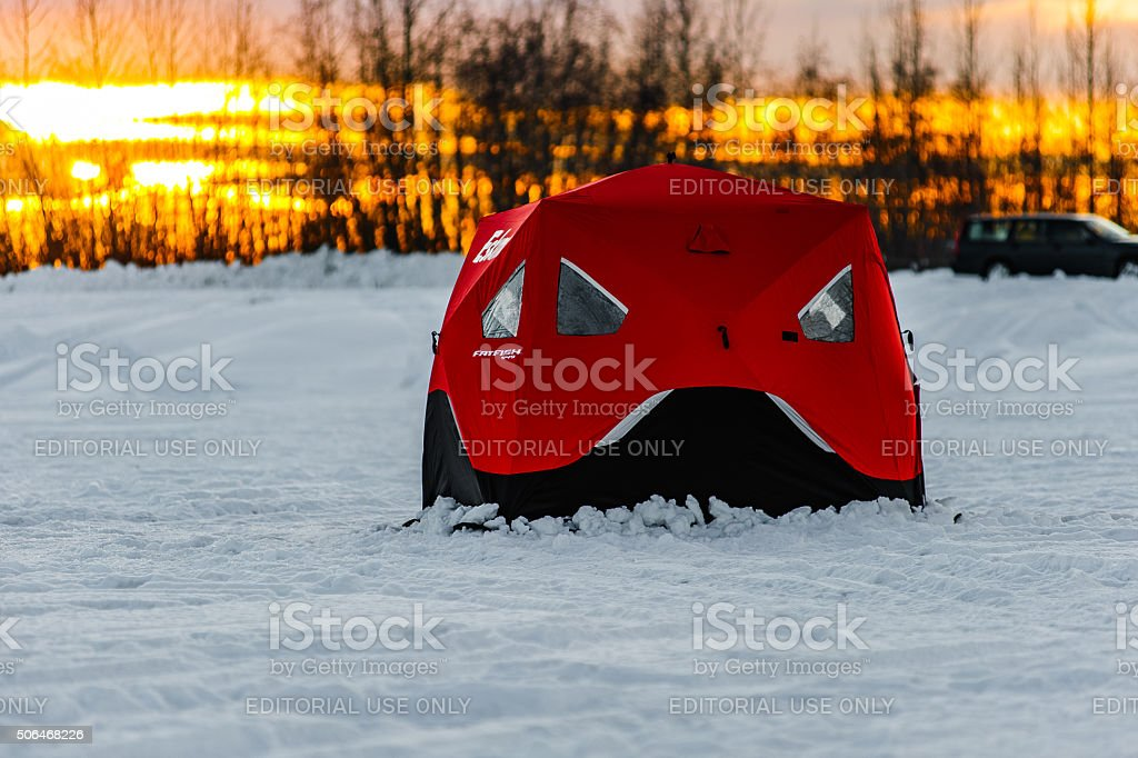 Ice Fishing with a view stock photo