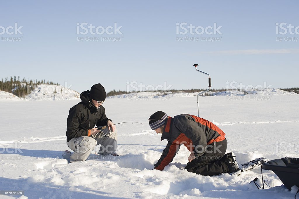 Ice Fishing, Yellowknife. stock photo