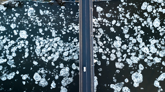 Ice floes floating on the river. River bridge