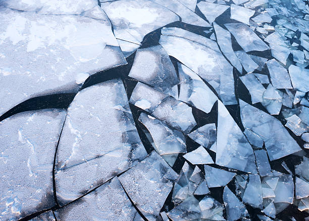 Ice floes on the river on a cold winter day Ice floes on the river on a cold winter day at sunset ice floe stock pictures, royalty-free photos & images