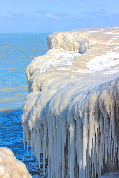 Ice formations along a lakefront stock photo