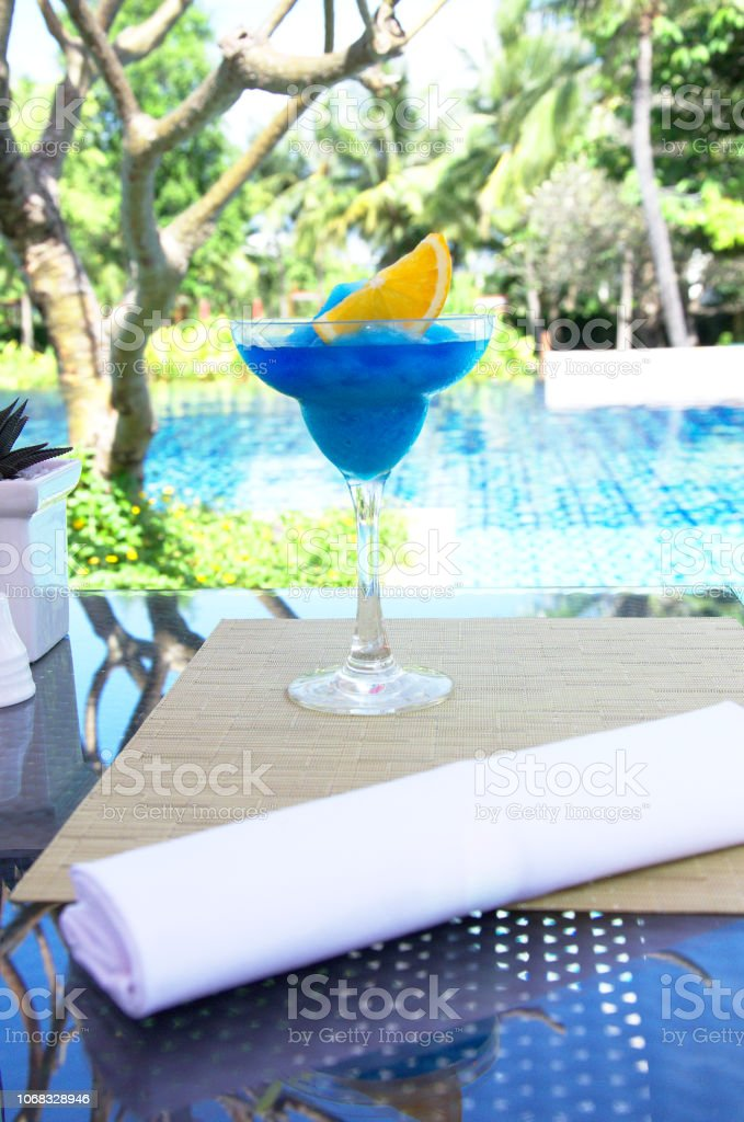 Ice fresh cocktail  on blue pool background stock photo