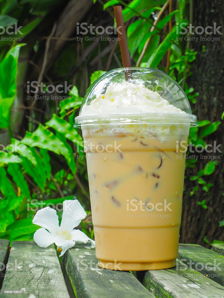 ice glass coffee on wooden in the garden stock photo