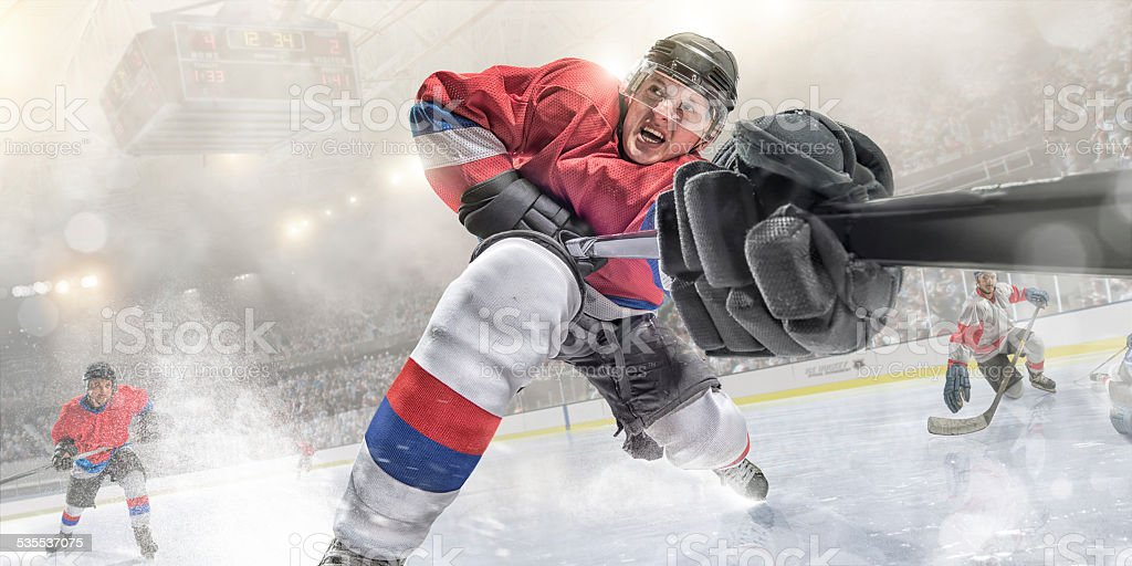 Ice Hockey Action in Extreme Close Up stock photo
