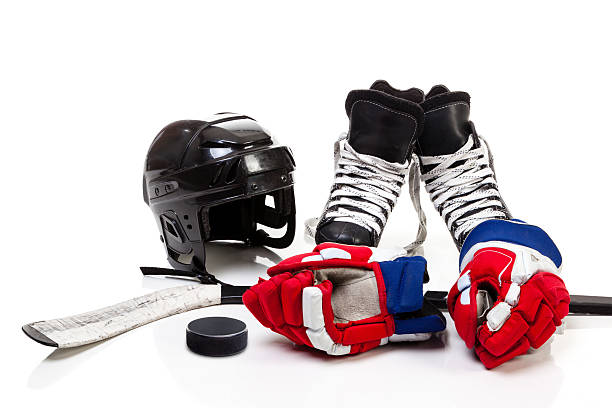 ice hockey equipment isolated on white background - sports glove stock photos and pictures