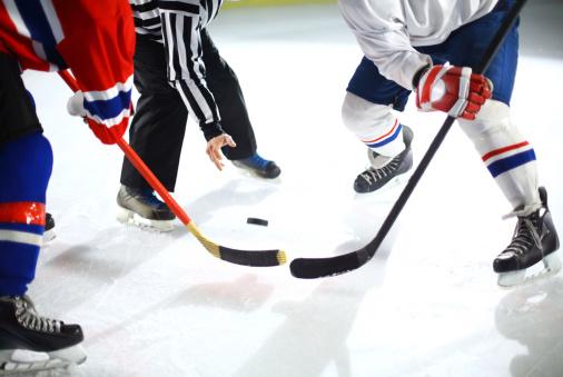 Ice hockey face off.