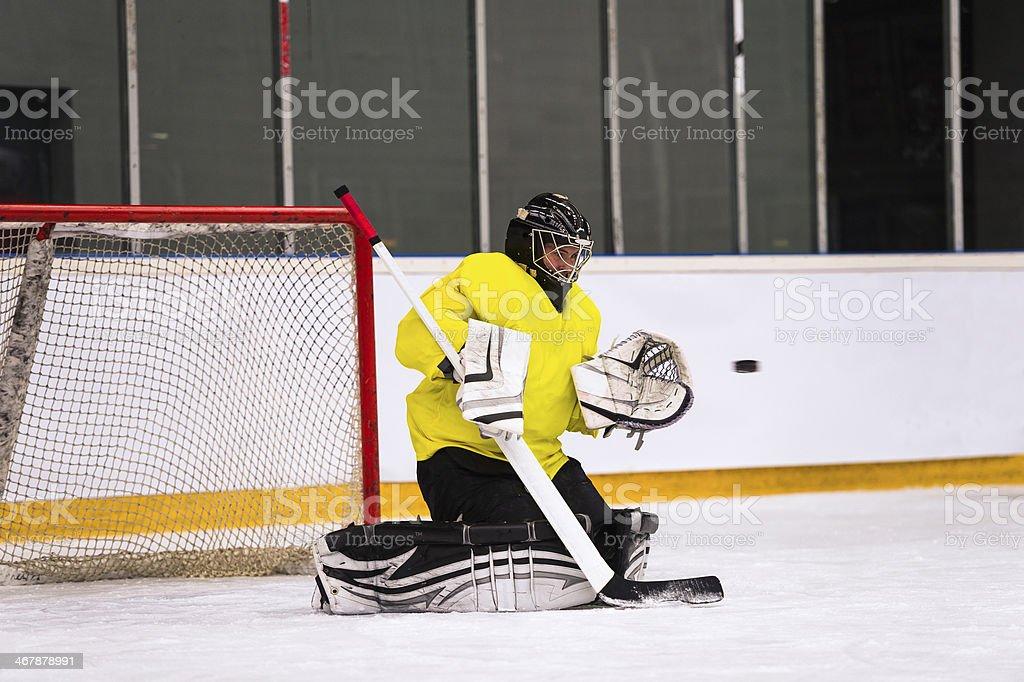 Ice Hockey Goalie Defending royalty-free stock photo