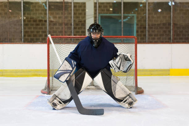 Ice Hockey Goaltender defending his goal stock photo