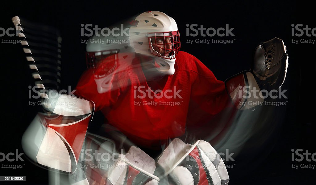 Ice Hockey Goaltender In Action On A Black Background Stock Photo