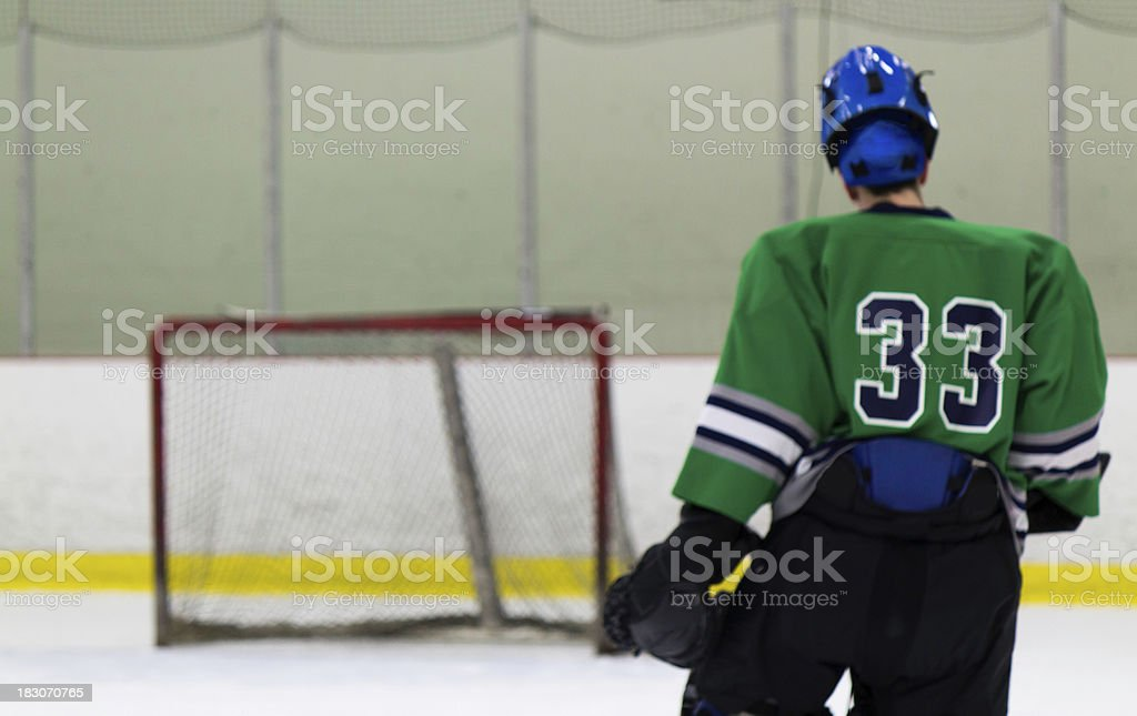 Ice Hockey goaltender skates to his net royalty-free stock photo