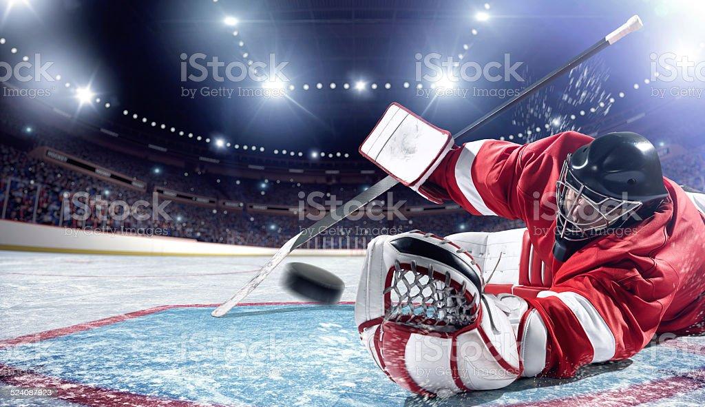Ice Hockey golie in action stock photo