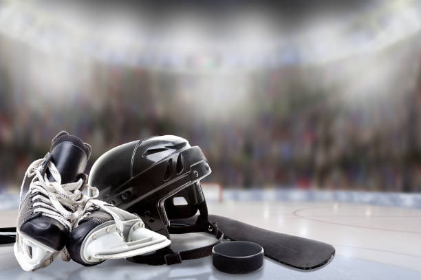 ice hockey helmet, skates, stick and puck in rink - hockey foto e immagini stock