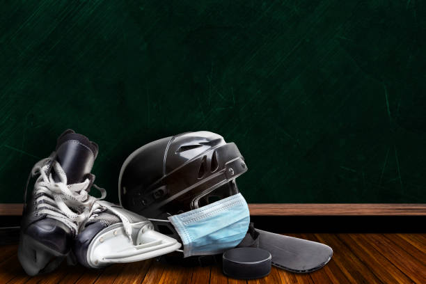 Ice Hockey Helmet Wearing Mask With Chalkboard Background and Copy Space stock photo
