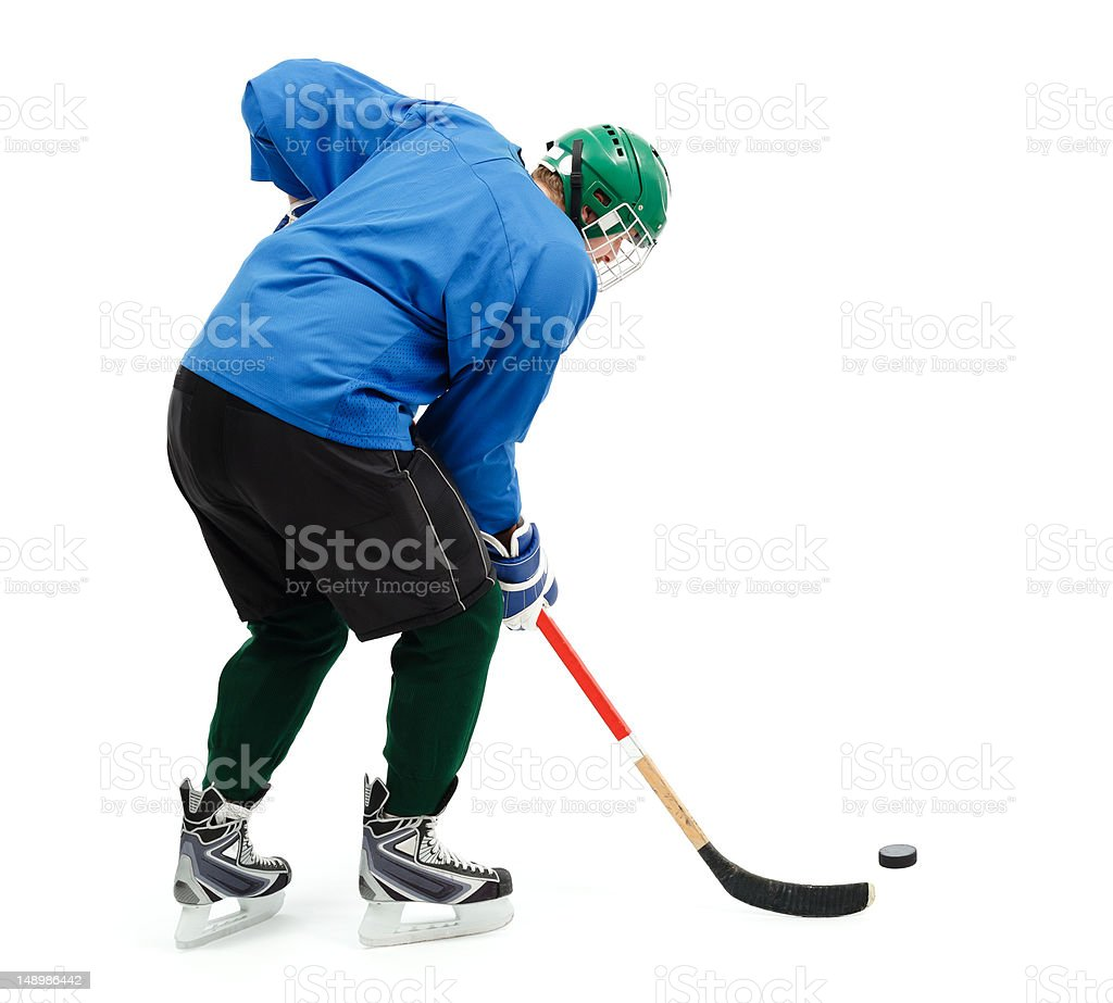 Ice hockey player in blue royalty-free stock photo