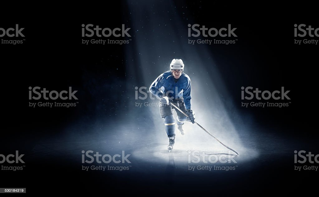 Ice hockey player is spotlight stock photo