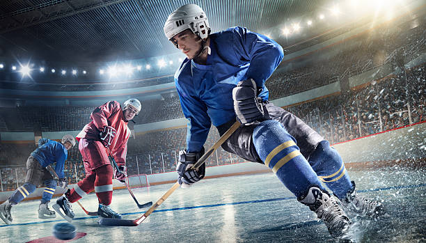 ice hockey player on hockey arena - hockey stock pictures, royalty-free photos & images