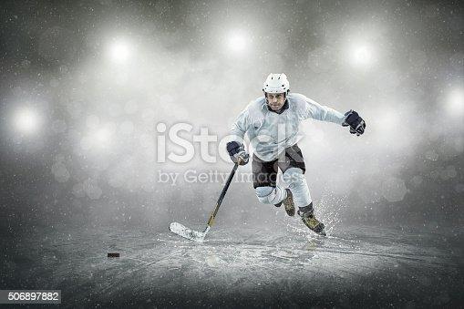 istock Ice hockey player on the ice, outdoors 506897882