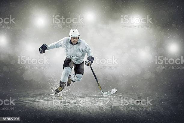 Photo of Ice hockey player on the ice, outdoors