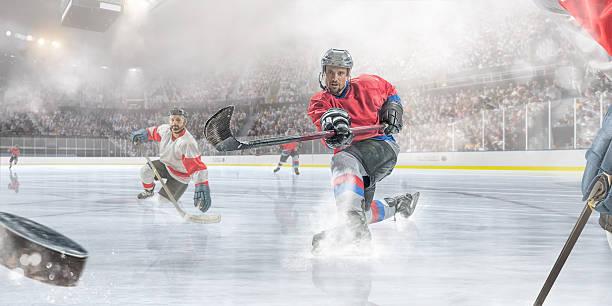 Jugador de Hockey sobre hielo de puntuación - foto de stock