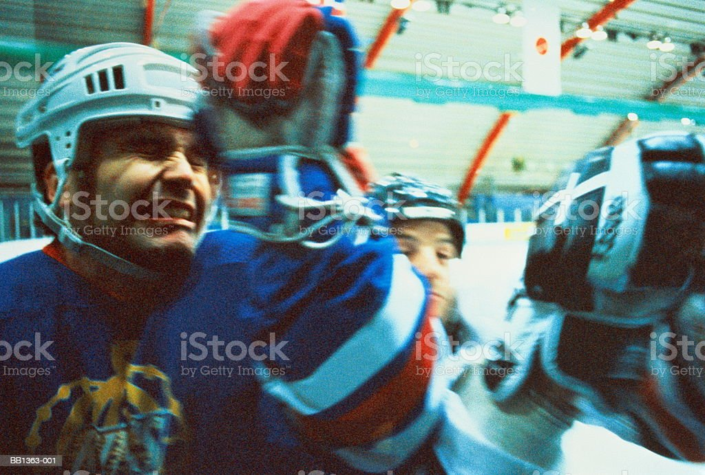 Ice hockey, players clashing during game (blurred motion) 免版稅 stock photo