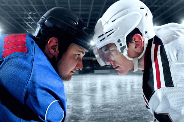 Ice hockey players from opposing teams face to face stock photo