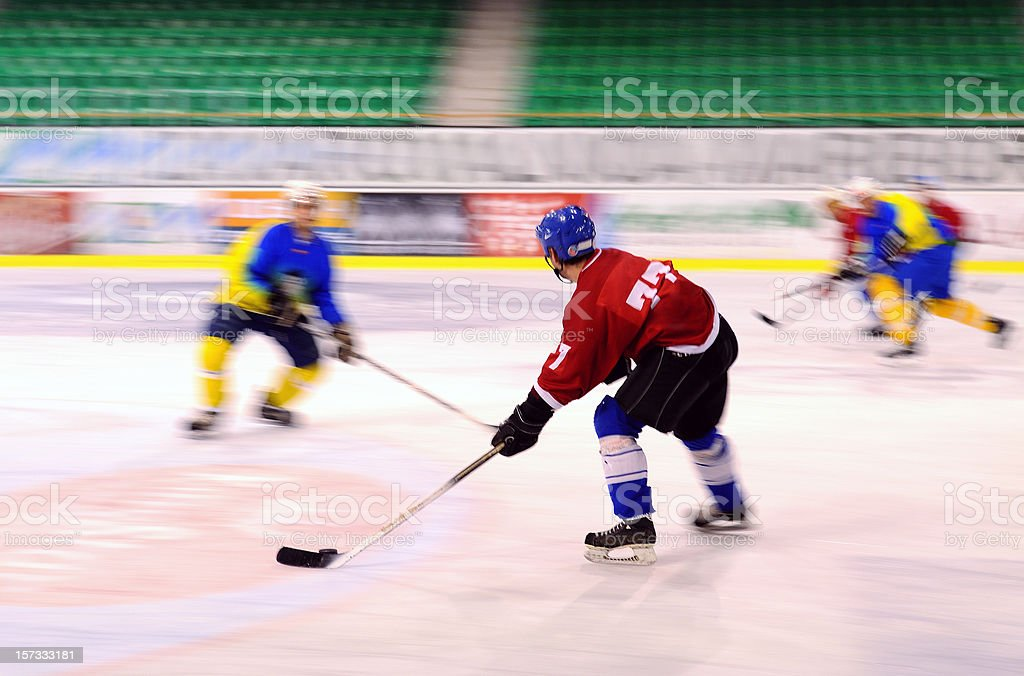 Ice hockey players in the action royalty-free stock photo