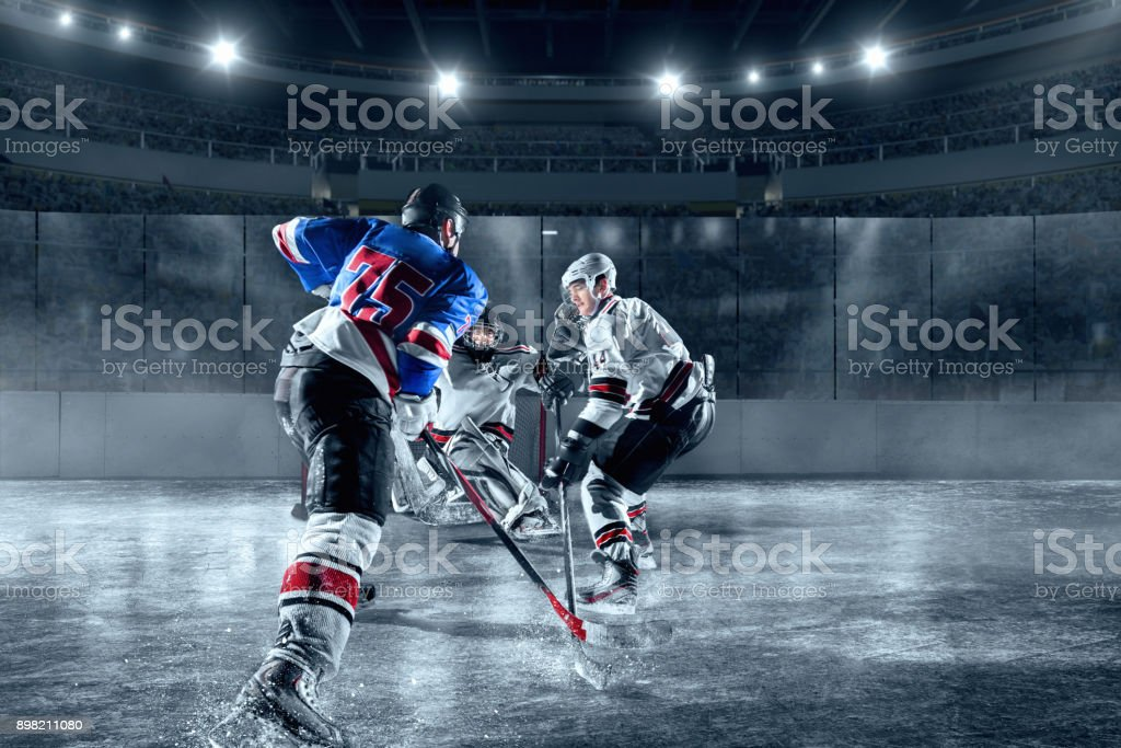 Ice hockey players on big professional ice arena stock photo