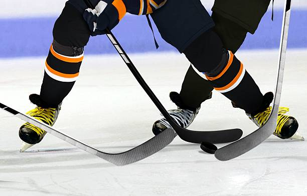 ice hockey players on rink - hockey stick stock pictures, royalty-free photos & images