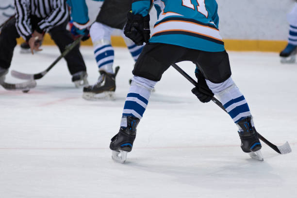 ice hockey players play ice hockey - hockey stock pictures, royalty-free photos & images