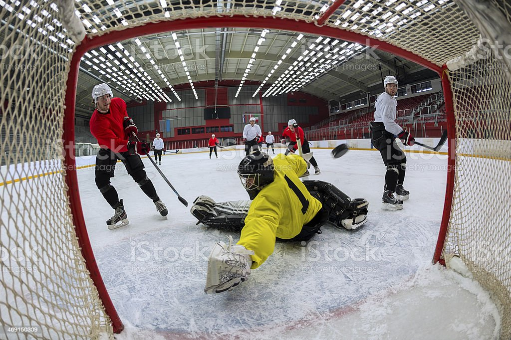 Ice Hockey Players Scoring the Goal stock photo