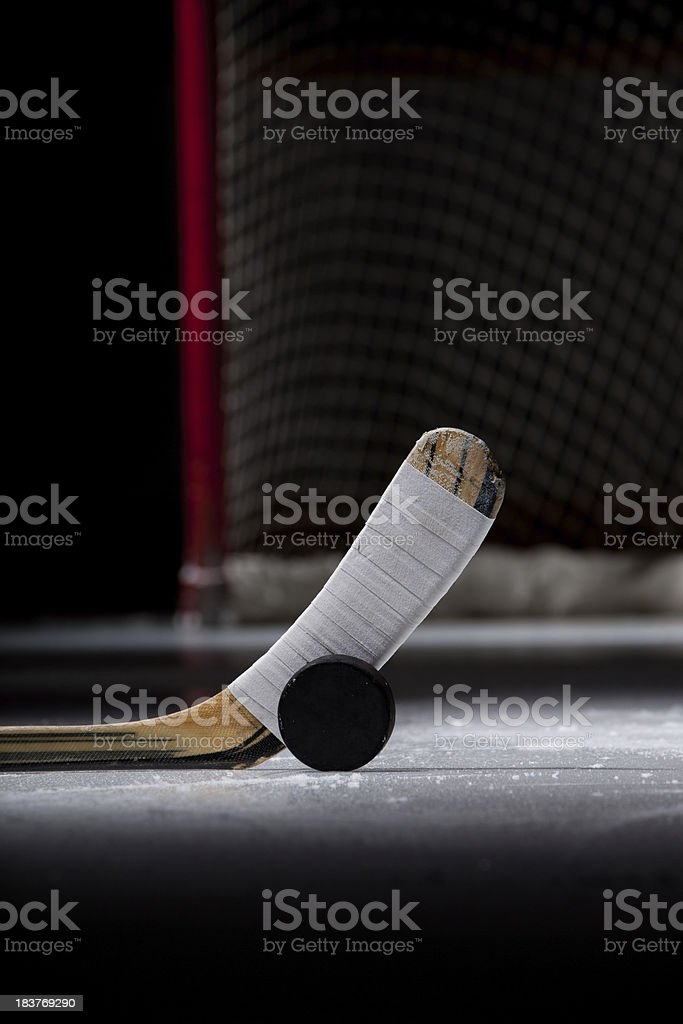 Ice Hockey Puck and Stick royalty-free stock photo