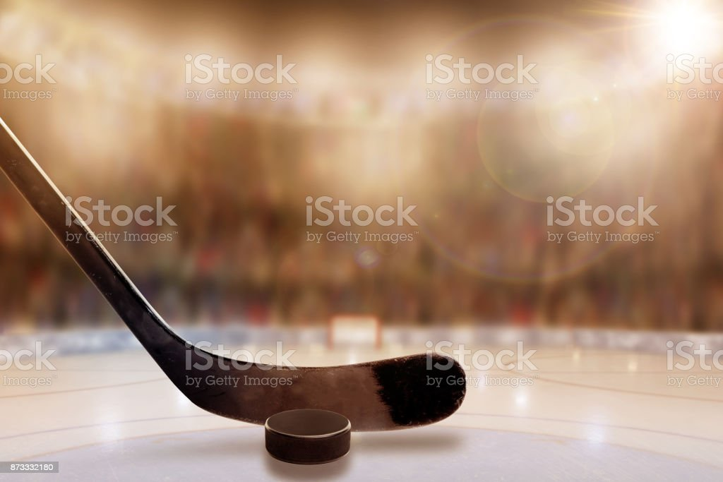 Ice Hockey Stick and Puck in Rink With Copy Space stock photo