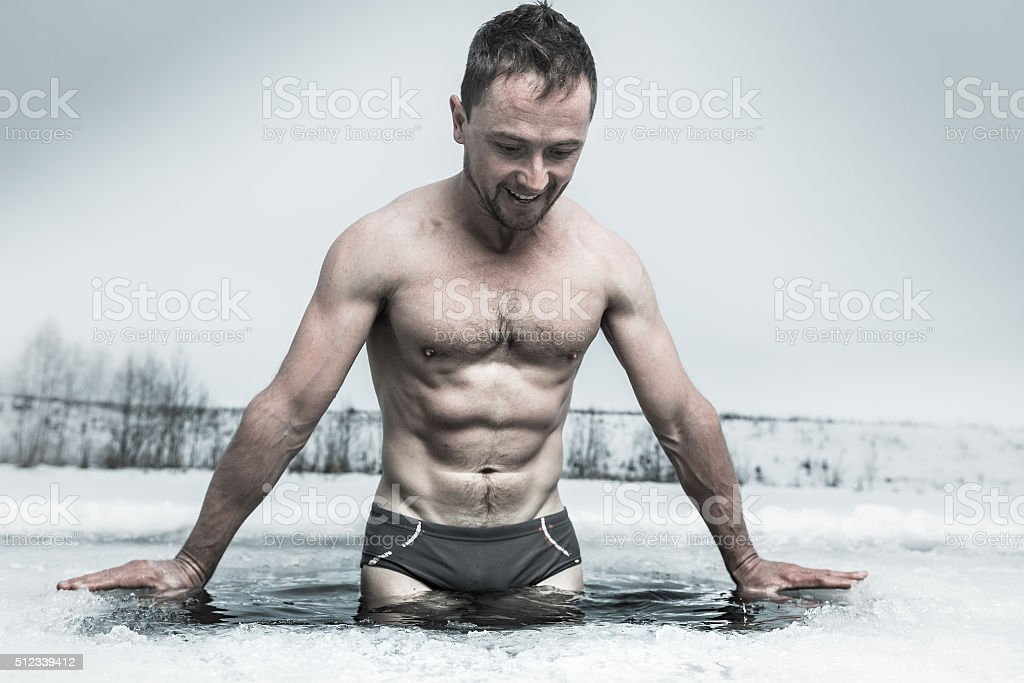 Ice hole swimming stock photo