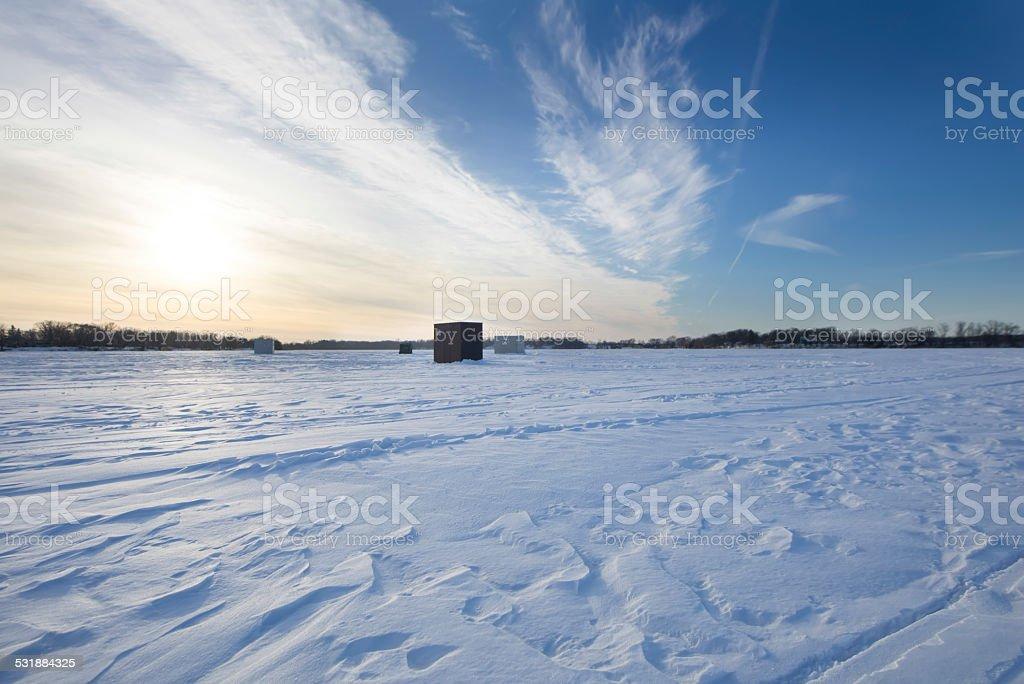 Ice House on Frozen Lake stock photo