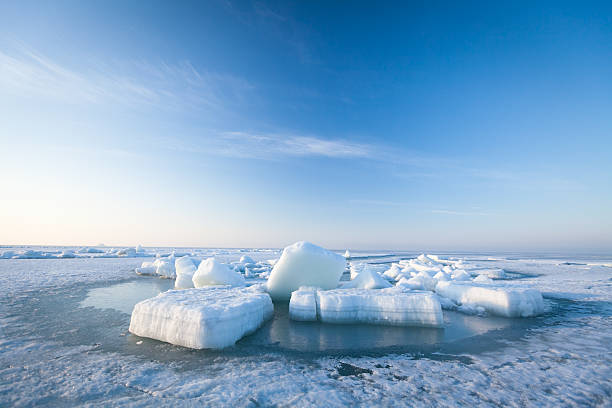 Ice hummocks swim in the sea Ice hummocks swim in the sea. ice floe stock pictures, royalty-free photos & images