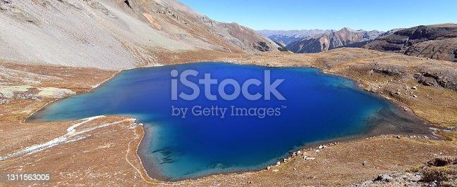 Ice  Lake is a wonderful mountain lake in the San Juan Mountains near Silverton, Colorado, USA. Popular Ice Lake Trail visible around the lake.