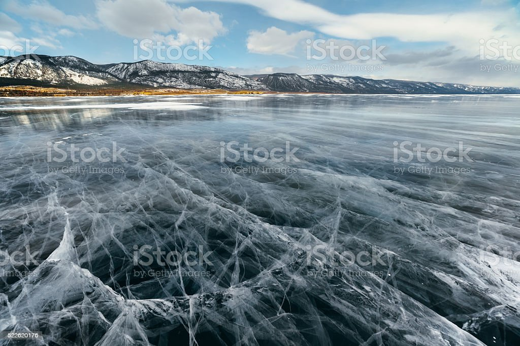 Ice lake with cracks. stock photo