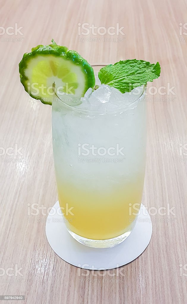 ice leech lime  on wood table, low aperture stock photo