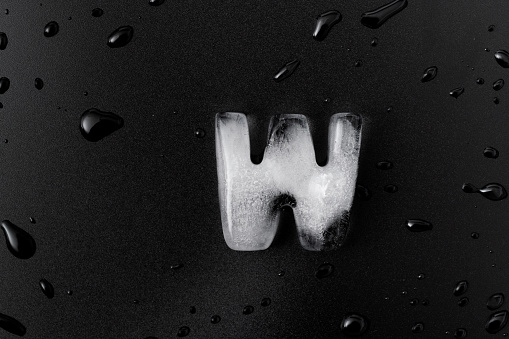Ice letter W on black background.