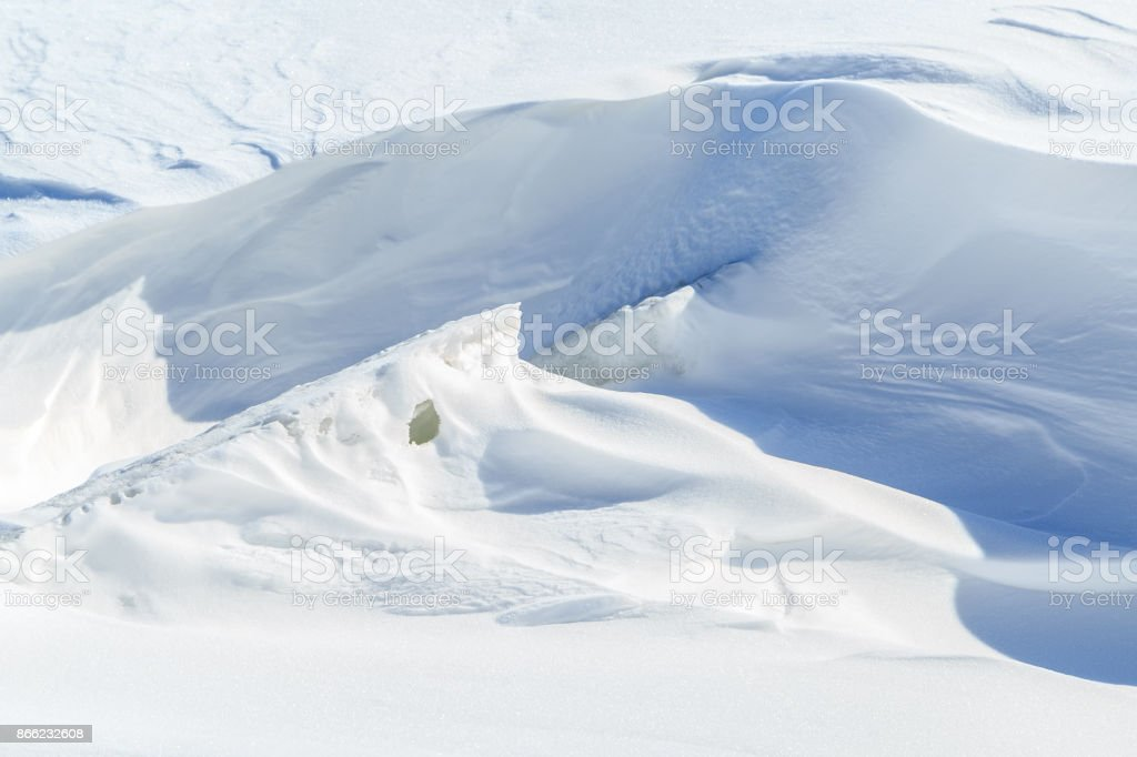 Ice lumps and big snowdrifts on a sunny winter day stock photo