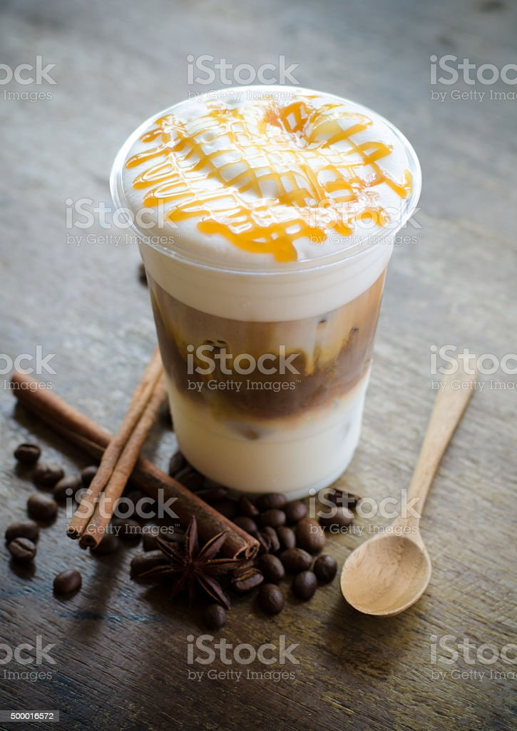 ice macchiato coffee on wooden table stock photo