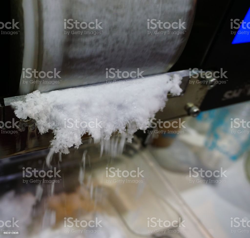 Ice maker with snow stock photo