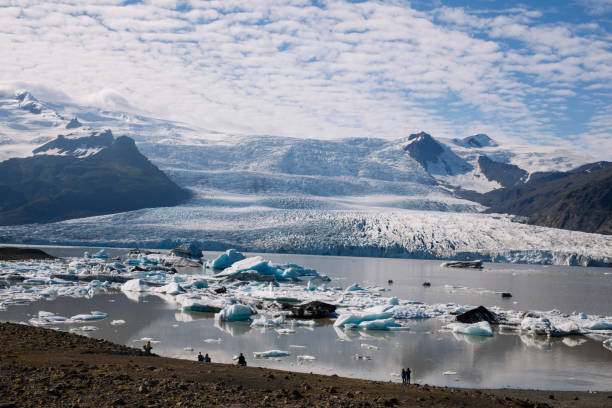 Ice melting in glacier lagoon Pieces of ice from glaciers melting and forming the beautiful lagoon. glacier lagoon stock pictures, royalty-free photos & images