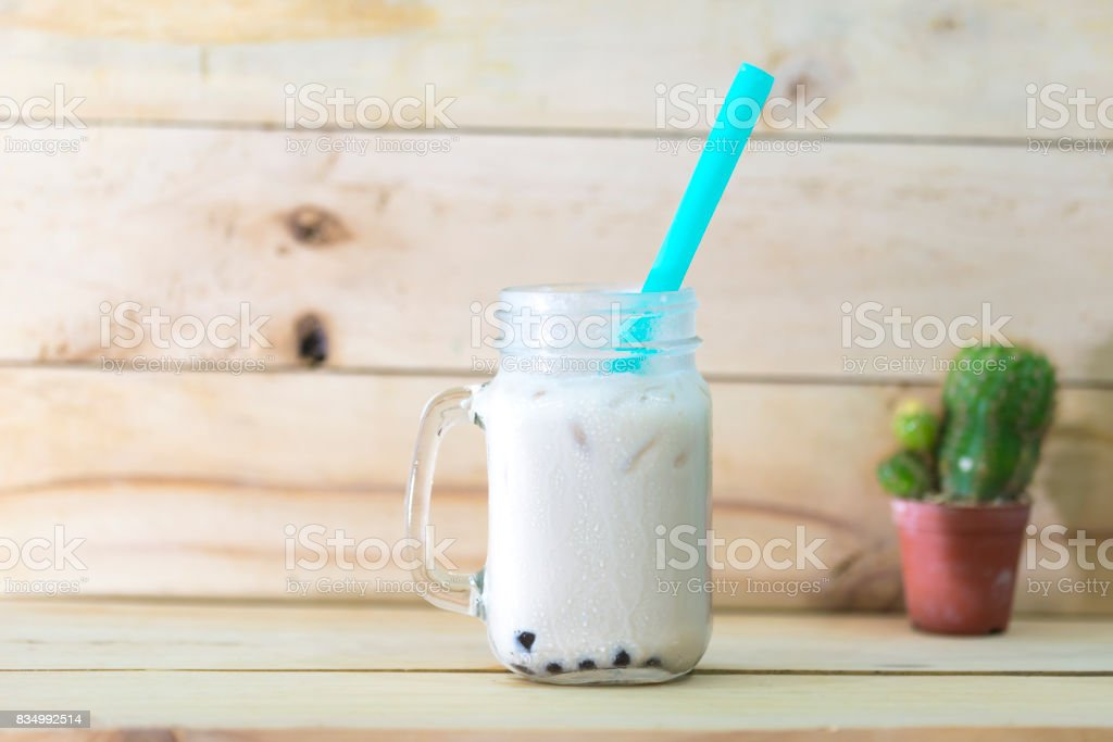 Ice mixed milk and tea with bubble in a cup. stock photo