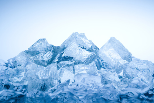 Iceberg with its visible tip and underwater or submerged part floating in the ocean. 3D rendering illustration.