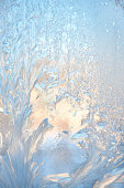 Frosty pattern at a winter window glass