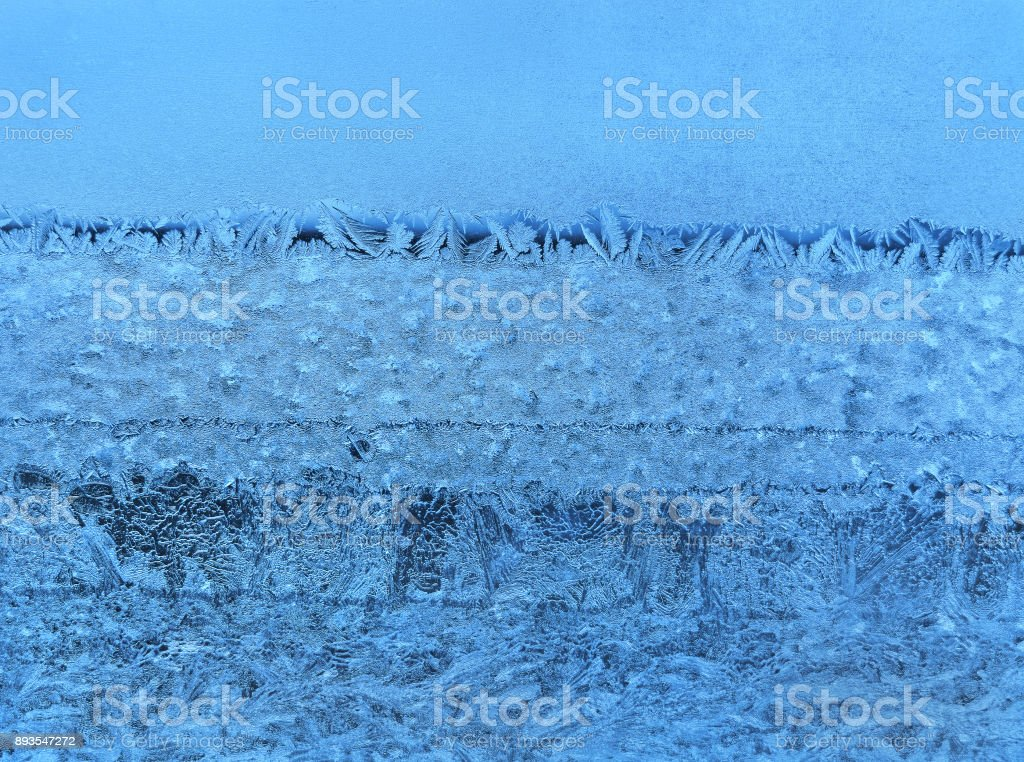 Ice natural pattern on winter window glass stock photo