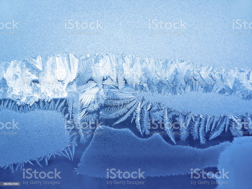 Ice natural pattern on winter window stock photo