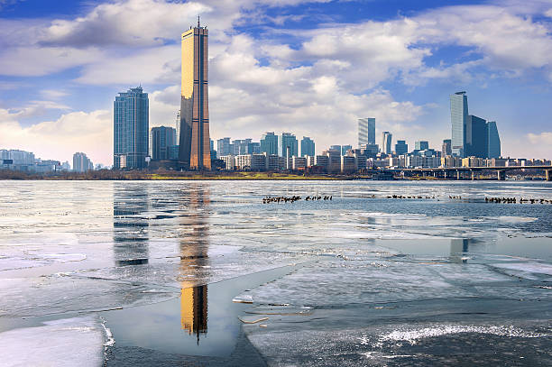 Ice of Han river and cityscape in winter,Seoul Korea. stock photo